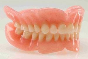 Làm răng giả tháo lắp bằng nhựa.